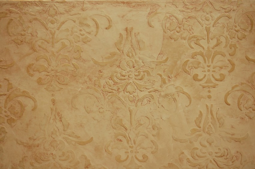 Stenciled Venetian plaster with bronze metallic wax